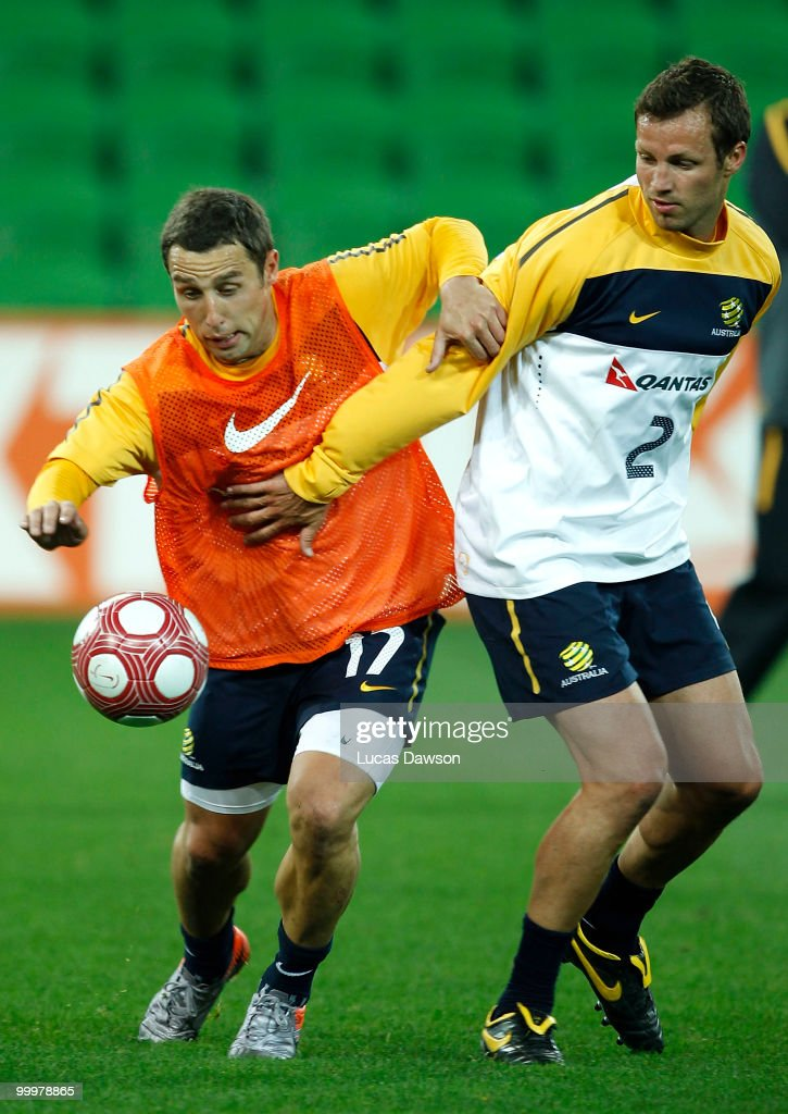 Scott Mcdonald and Lucas Neill of the Socceroos contest for the ball during an Australian Socceroos training session at AAMI Park on May 19 2010 in...
