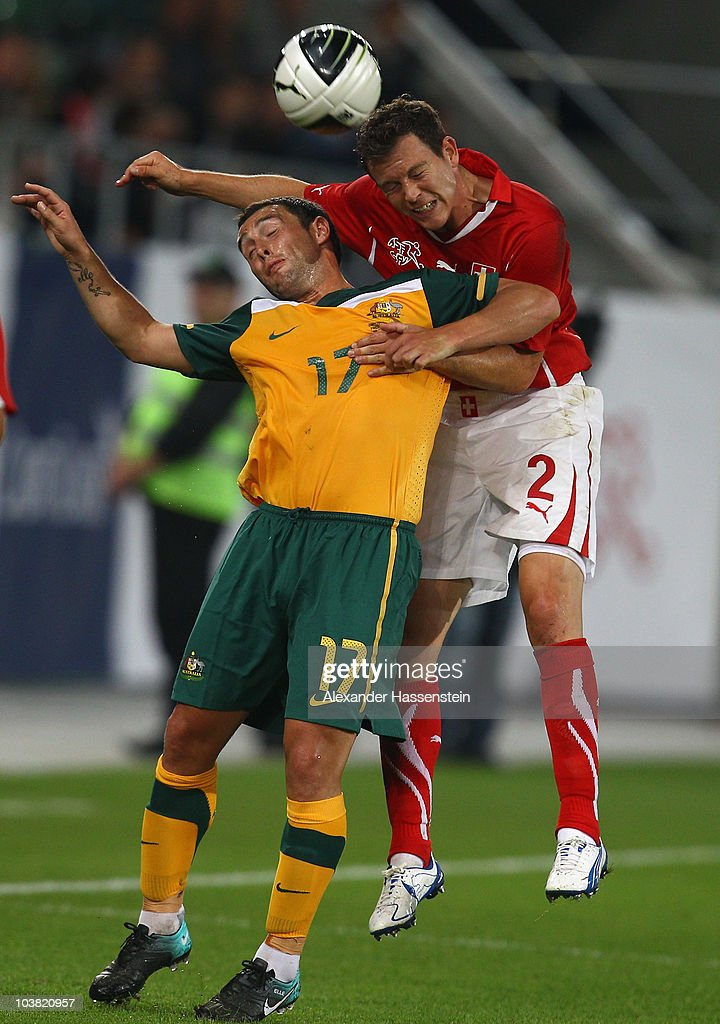 Scott McDonald of Australia battles for the ball with Stephan Lichtsteiner of Switzerland during an International friendly match between Switzerland...