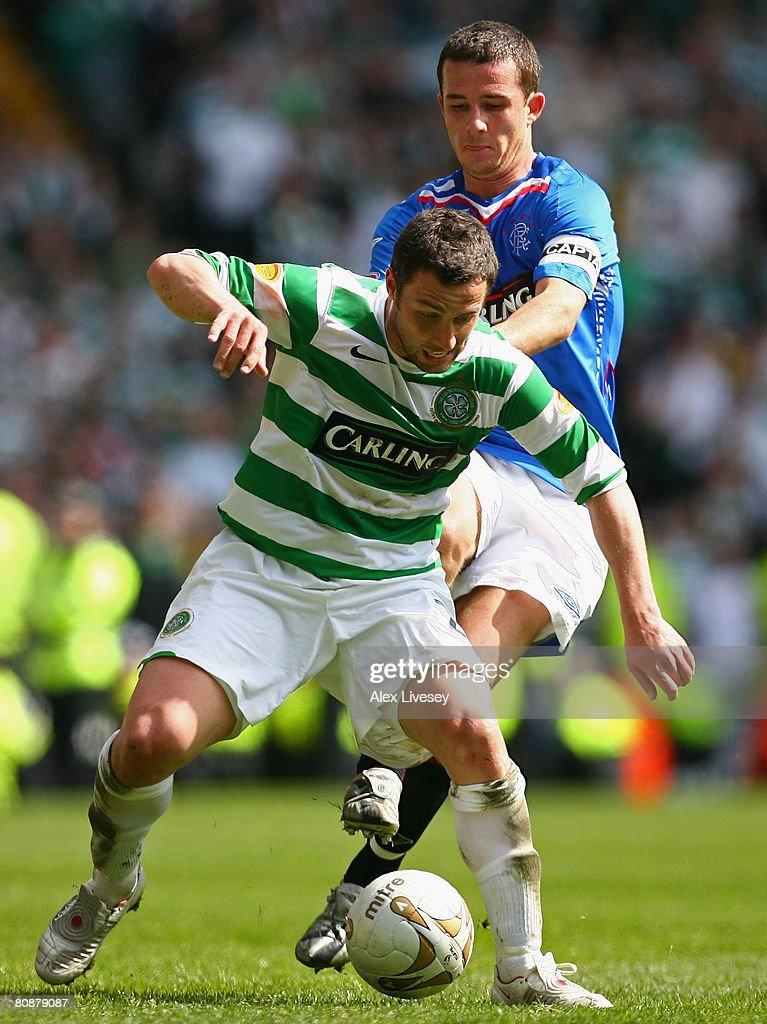 Scott McDonald of Celtic holds off a challenge from Barry Ferguson of Rangers during the Clydesdale Bank Scottish Premier League match between Celtic...