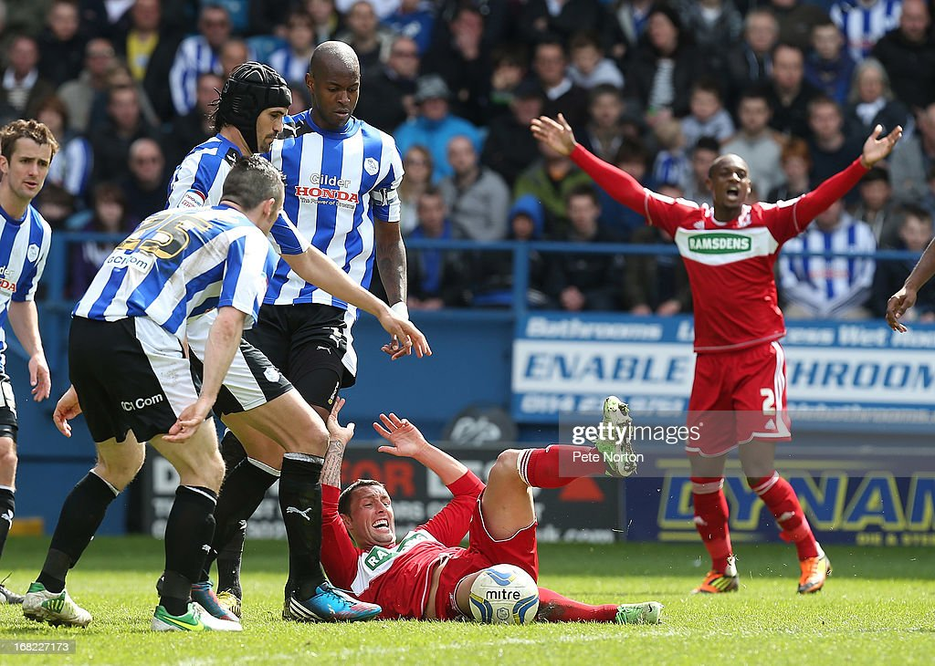 Scott McDonald of Middlesbrough goes to ground as David Prutton Miguel llera and Anthony Gardner of Sheffield Wednesday look on during the npower...