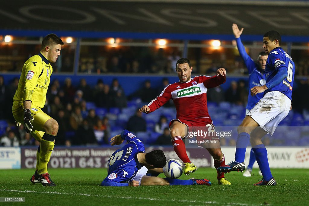 Scott McDonald of Middlesbrough has a shot blocked by Pablo Ibanez as Curtis Davies and Jack Butland look on of Birmingham City and of Middlesbrough...