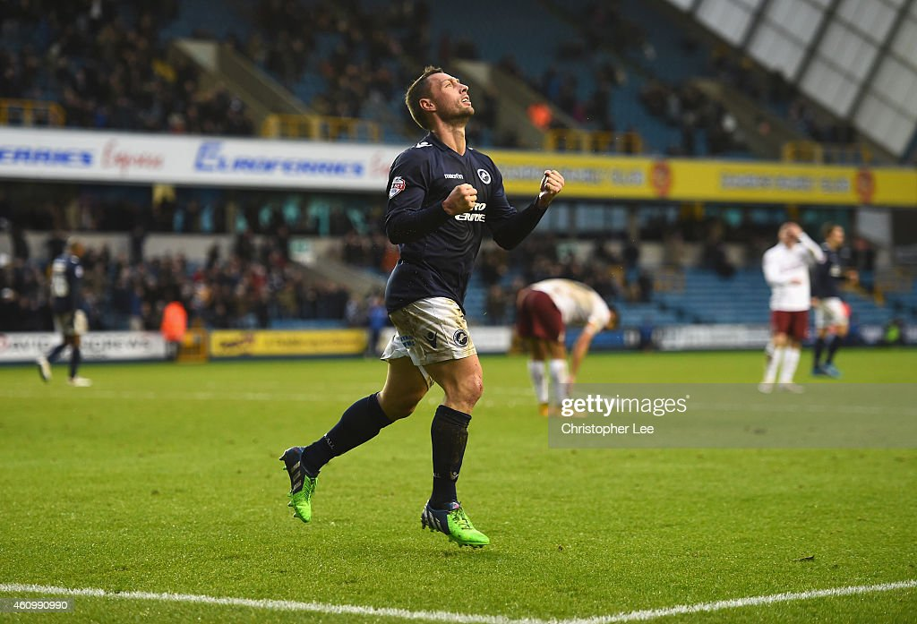 Scott McDonald of Millwall celebrates scoring their first goal during the FA Cup Third Round match between Millwall and Bradford City at The Den on...