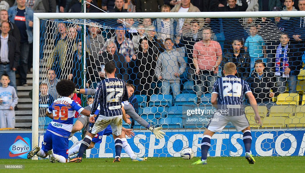 Scott McDonald of Millwall FC scores during the Sky Bet Championship match between Millwall and Queens Park Rangers at The Den on October 19 2013 in...