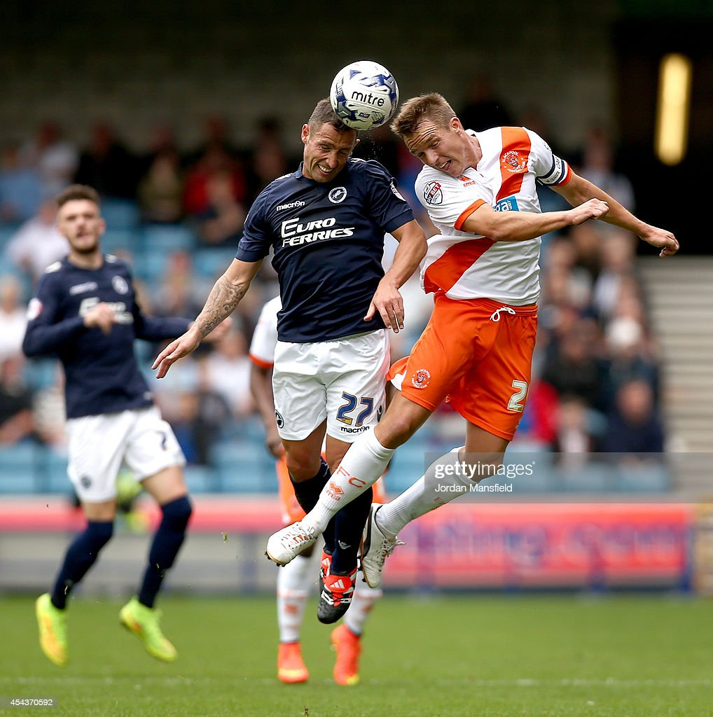 Scott McDonald of Millwall goes up for a header with Tony McMahon of Blackpool during the Sky Bet Championship match between Millwall and Blackpool...