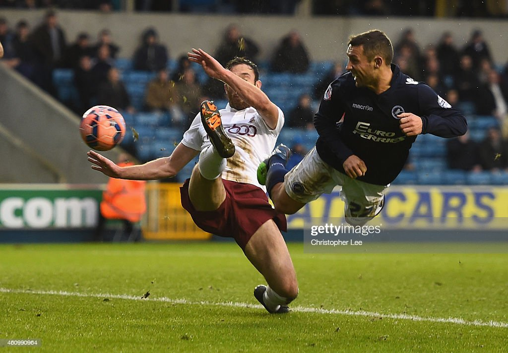 Scott McDonald of Millwall scores their first goal as Rory McArdle of Bradford tries to stop him during the FA Cup Third Round match between Millwall...