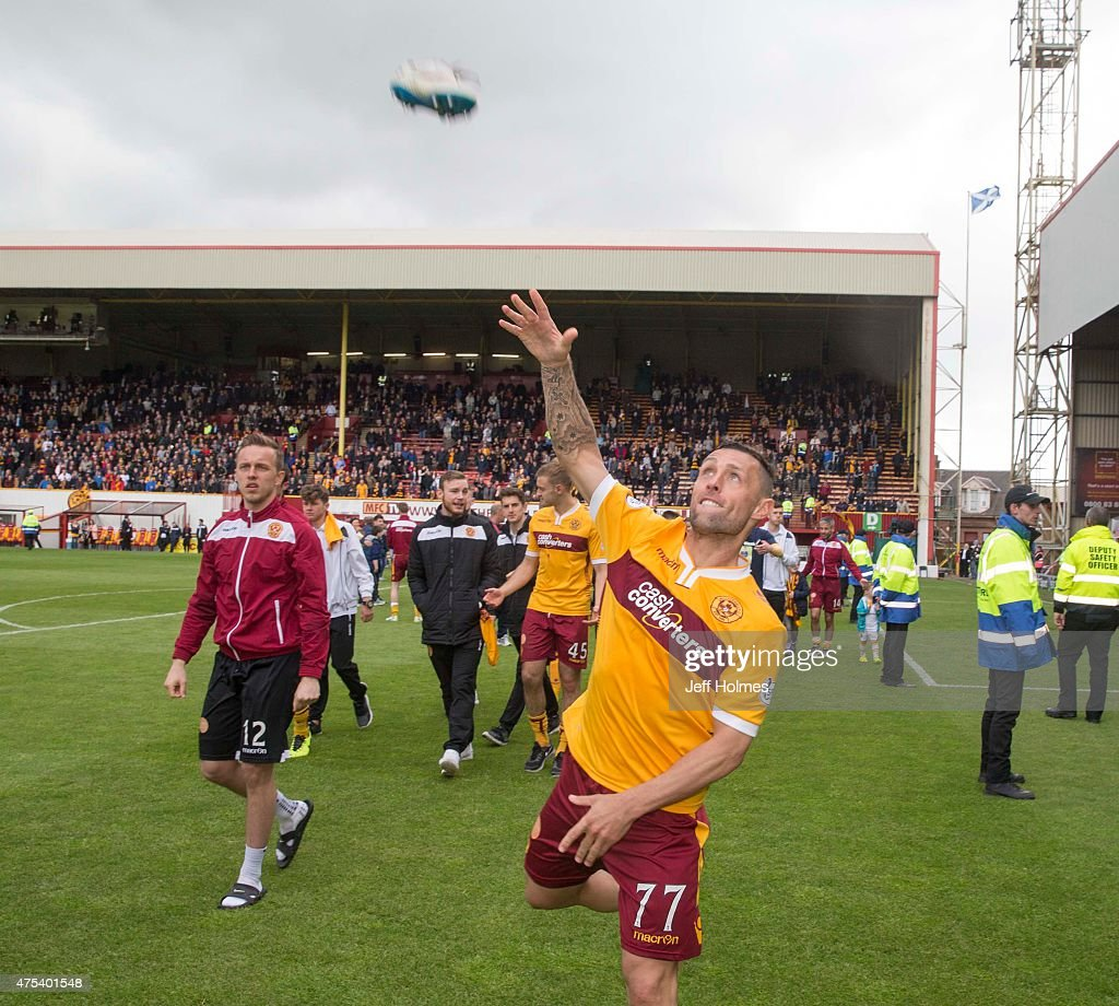 Scott McDonald of Motherwell throws his shoes into the crowd during the Scottish Premiership playoff final 2nd leg between Motherwell and Rangers at...