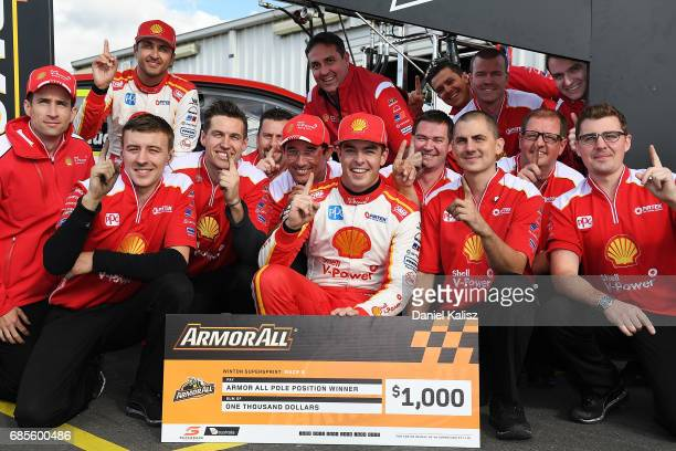Scott McLaughlin driver of the Shell VPower Racing Team Ford Falcon FGX celebrates after taking pole position for race 9 for the Winton SuperSprint...