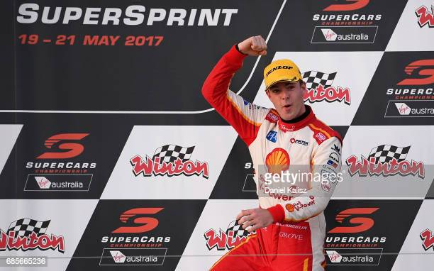 Scott McLaughlin driver of the Shell VPower Racing Team Ford Falcon FGX celebrtates on the podium after race 9 for the Winton SuperSprint which is...