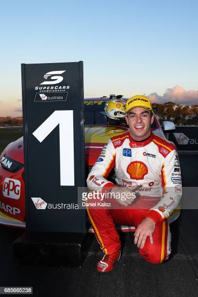 Scott McLaughlin driver of the Shell VPower Racing Team Ford Falcon FGX celebrates after winnign race 9 for the Winton SuperSprint which is part of...