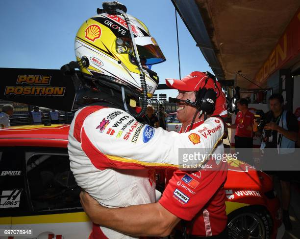 Scott McLaughlin driver of the Shell VPower Racing Team Ford Falcon FGX and Ludo Lacroix engineering director at Shell VPower Racing Team celebrate...