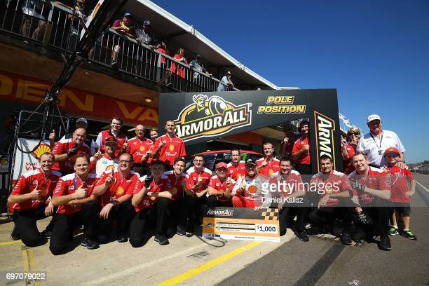 Scott McLaughlin driver of the Shell VPower Racing Team Ford Falcon FGX celebrates after taking pole position for race 12 during the top ten...