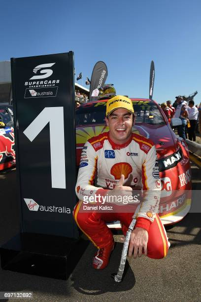 Scott McLaughlin driver of the Shell VPower Racing Team Ford Falcon FGX celebrates after winning race 12 for the Darwin Triple Crown which is part of...
