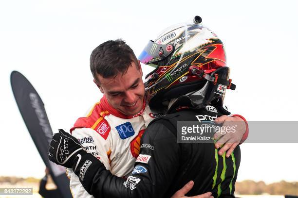 Scott McLaughlin driver of the Shell VPower Racing Team Ford Falcon FGX celebrates with Cameron Waters driver of the Monster Energy Ford Falcon FGX...