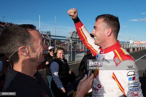 Scott McLaughlin driver of the Shell VPower Racing Team Ford Falcon FGX celebrates after taking pole position during the top ten shootout ahead of...
