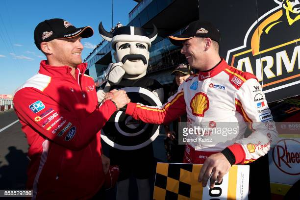 Scott McLaughlin driver of the Shell VPower Racing Team Ford Falcon FGX celebrates with his team mate Alex Premat driver of the Shell VPower Racing...