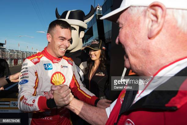 Scott McLaughlin driver of the Shell VPower Racing Team Ford Falcon FGX celebrates with Dick johnson team owner of Dick Johnson Racing after taking...