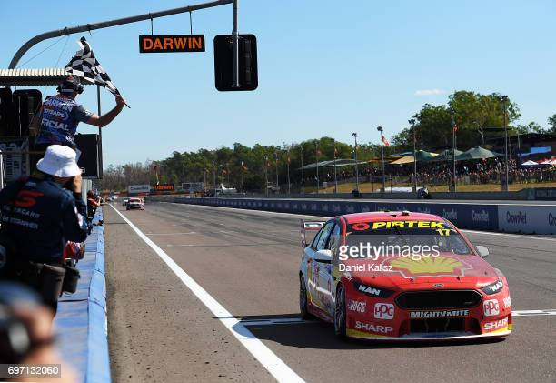 Scott McLaughlin drives the Shell VPower Racing Team Ford Falcon FGX takes the chequered flag to win race 12 during the Darwin Triple Crown which is...