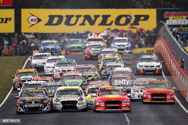 Scott McLaughlin drives the Shell VPower Racing Team Ford Falcon FGX Mark Winterbottom drives the The BottleO Racing Ford Falcon FGX and David...