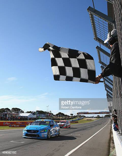 Scott McLaughlin driving the Valvoline Racing GRM Volvo gets past Garth Tander driving the Holden Racing Team Holden on the finish line during race...