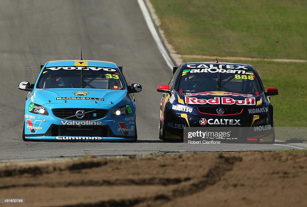 Scott McLaughlin driving the #33 Valvoline Racing GRM Volvo gets past <a gi-track='captionPersonalityLinkClicked' href=/galleries/search?phrase=Craig+Lowndes&family=editorial&specificpeople=213462 ng-click='$event.stopPropagation()'>Craig Lowndes</a> driving the #888 Red Bull Racing Australia Holden to take the lead during race 14 at the Perth 400, which is round five of the V8 Super Championship Series at Barbagallo Raceway on May 17, 2014 in Perth, Australia.