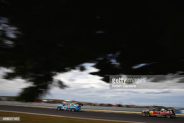 Scott McLaughlin driving the Valvoline Racing GRM Volvo is followed by Craig Lowndes driving the Red Bull Racing Australia Holden during race 33 at...