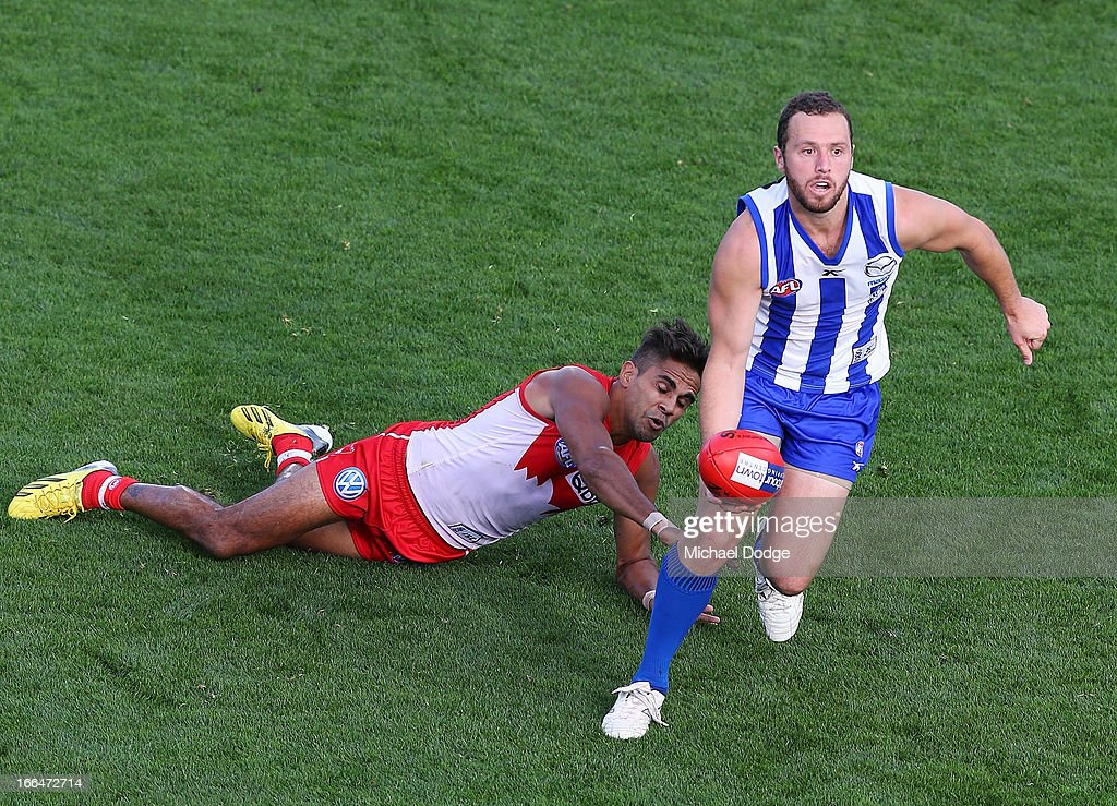 Scott McMahon of the Kangaroos runs with the ball away from <a gi-track='captionPersonalityLinkClicked' href=/galleries/search?phrase=Lewis+Jetta&family=editorial&specificpeople=6544948 ng-click='$event.stopPropagation()'>Lewis Jetta</a> of the Swans during the round three AFL match between the North Melbourne Kangaroos and the Sydney Swans at Blundstone Arena on April 13, 2013 in Hobart, Australia.