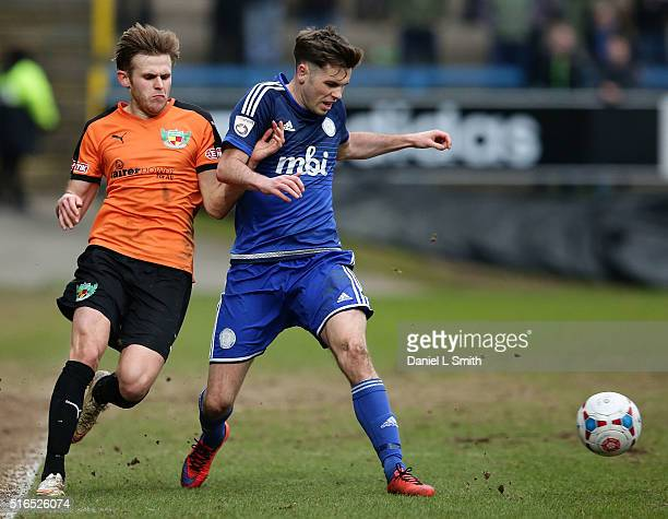 Scott McManus of FC Halifax Town under pressure from Andy White of Nantwich Town FC during the FA Trophy Semi Final Second Leg match between FC...