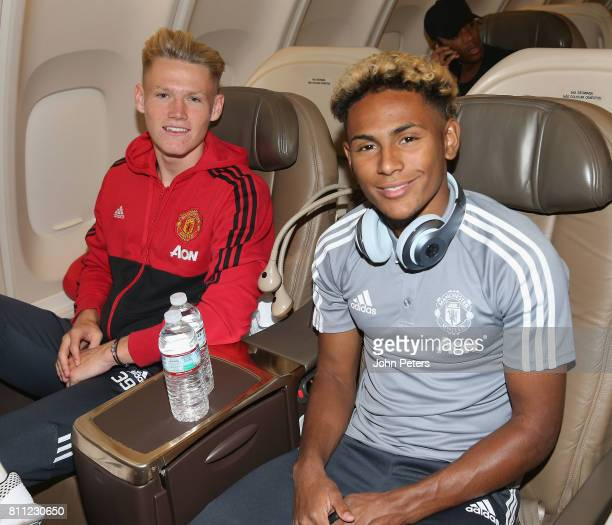 Scott McTominay and Demitri Mitchell of Manchester United sits on the aeroplane ahead of the club's preseason tour of the USA at Manchester Airport...