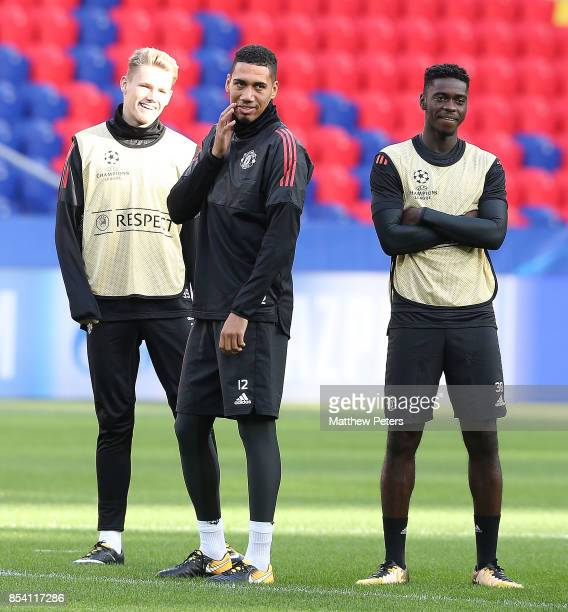 Scott McTominay Chris Smalling and Axel Tuanzebe of Manchester United in action during a training session ahead of their UEFA Champions League match...
