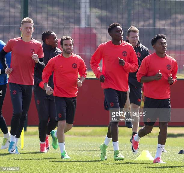 Scott McTominay Juan Mata Matthew Olosunde and Demitri Mitchell of Manchester United in action during a first team training session at Aon Training...