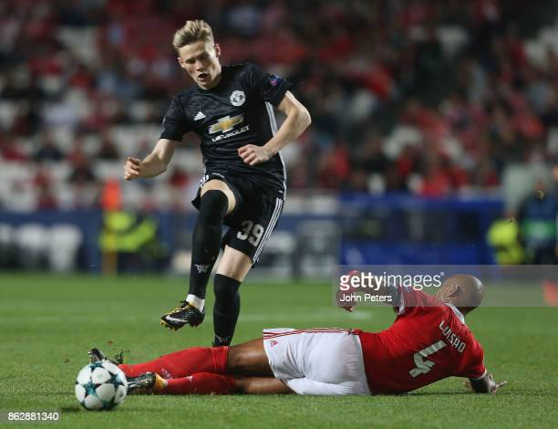 Scott McTominay of Mancester United is tackled by Luisao of Benfica who is sent off for the challenge during the UEFA Champions League group A match...