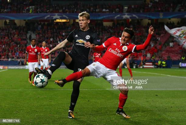 Scott McTominay of Manchester United and Franco Cervi of Benfica during the UEFA Champions League group A match between SL Benfica and Manchester...