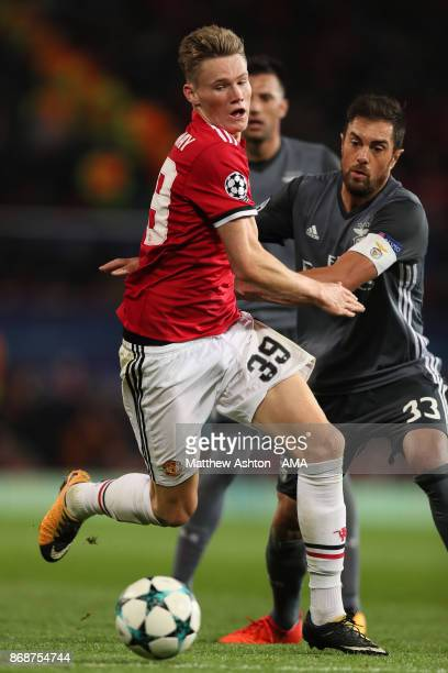 Scott McTominay of Manchester United battles for the ball with Jardel of Benfica during the UEFA Champions League group A match between Manchester...
