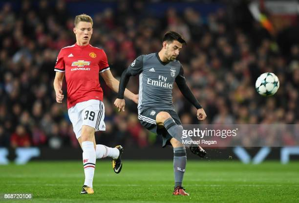 Scott McTominay of Manchester United chases down Pizzi of Benfica during the UEFA Champions League group A match between Manchester United and SL...