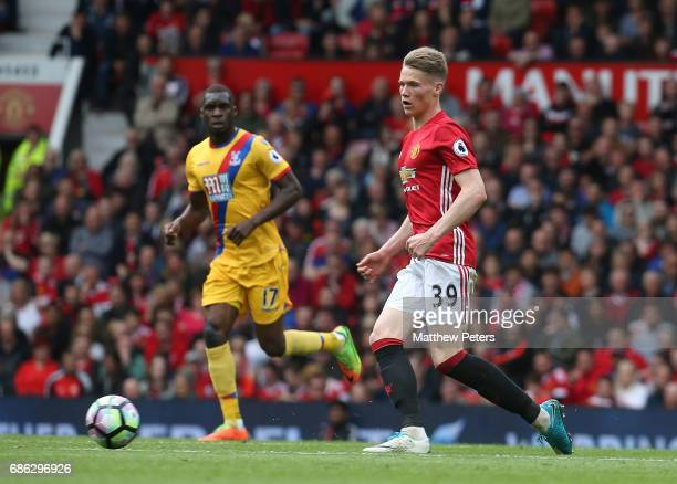Scott McTominay of Manchester United in action with Christian Benteke of Crystal Palace during the Premier League match between Manchester United and...