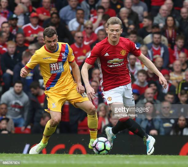 Scott McTominay of Manchester United in action with James McArthur of Crystal Palace during the Premier League match between Manchester United and...