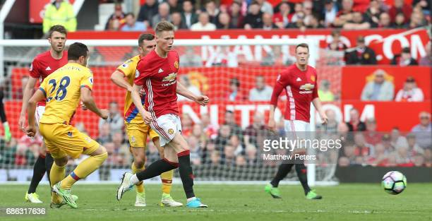 Scott McTominay of Manchester United in action with Luka Milivojevic of Crystal Palace during the Premier League match between Manchester United and...