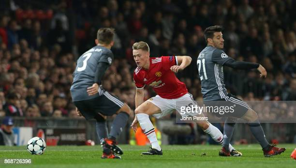 Scott McTominay of Manchester United in action with Pizzi of Benfica during the UEFA Champions League group A match between Manchester United and SL...