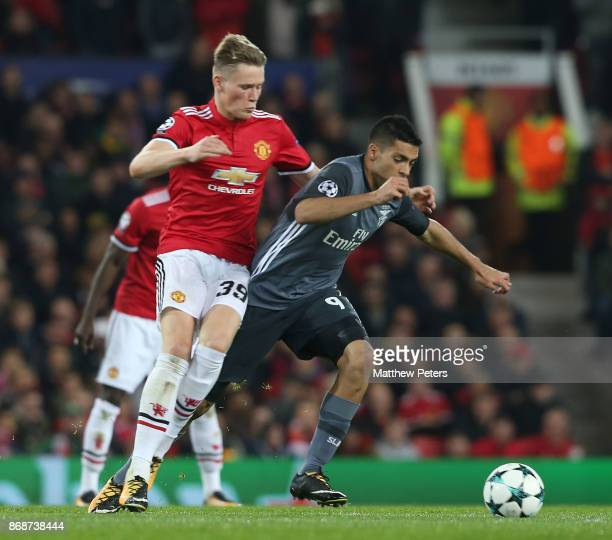 Scott McTominay of Manchester United in action woith Raul Jimenez of Benfica during the UEFA Champions League group A match between Manchester United...