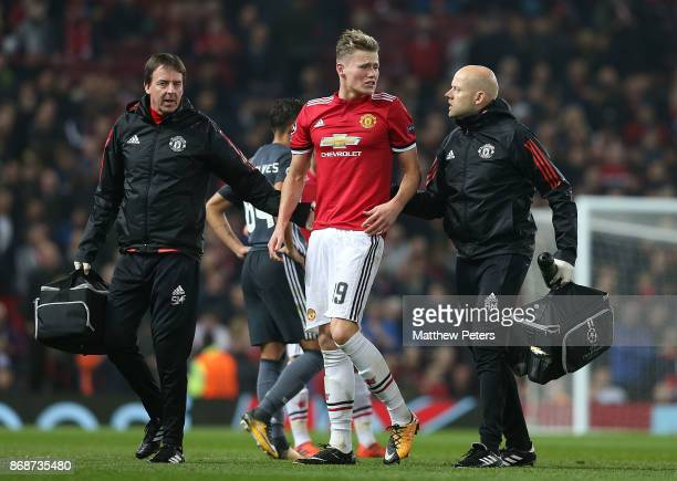 Scott McTominay of Manchester United receives treatment on an injury during the UEFA Champions League group A match between Manchester United and SL...