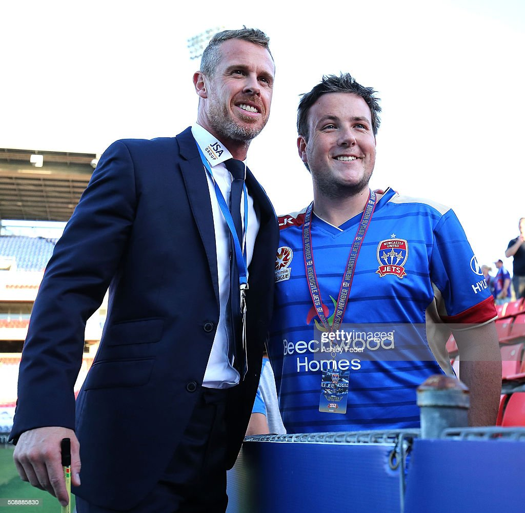 Scott Miller coach of the Jets celebrates the win with a fan during the round 18 A-League match between the Newcastle Jets and Melbourne City FC at Hunter Stadium on February 7, 2016 in Newcastle, Australia.