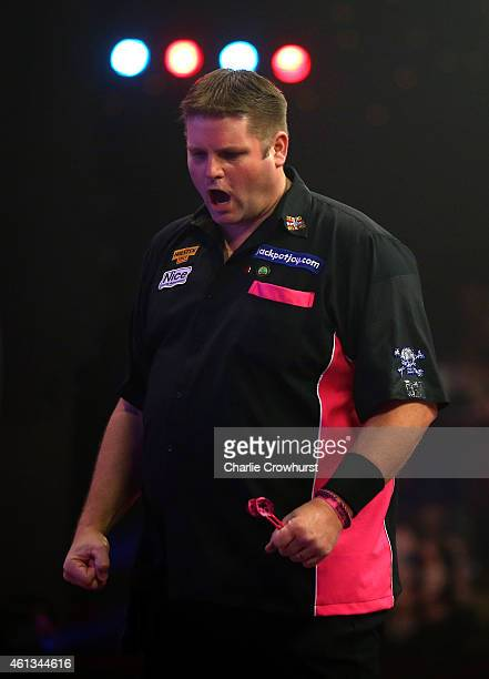 Scott Mitchell of England celebrates winning a set during the mens final against Martin Adams of England during the BDO Lakeside World Professional...