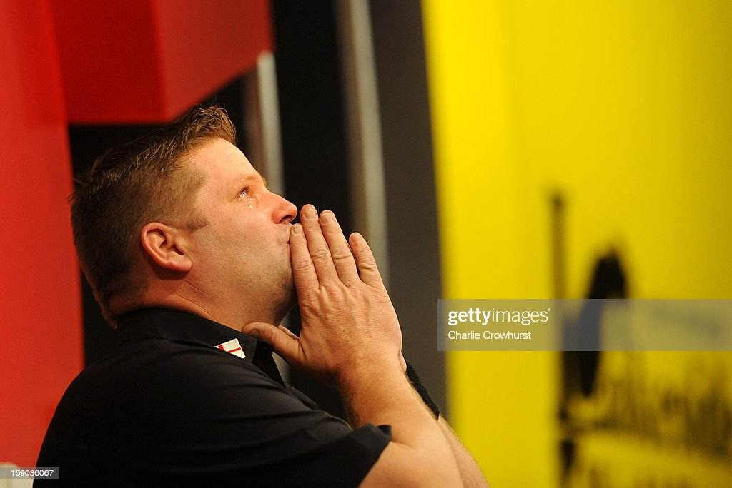 <a gi-track='captionPersonalityLinkClicked' href=/galleries/search?phrase=Scott+Mitchell&family=editorial&specificpeople=228843 ng-click='$event.stopPropagation()'>Scott Mitchell</a> of England gets emotional after he wins his first round match against Mark Barilli on day two of the BDO Lakeside World Professional Darts Championships at Lakeside Country Club on January 06, 2013 in London, England.
