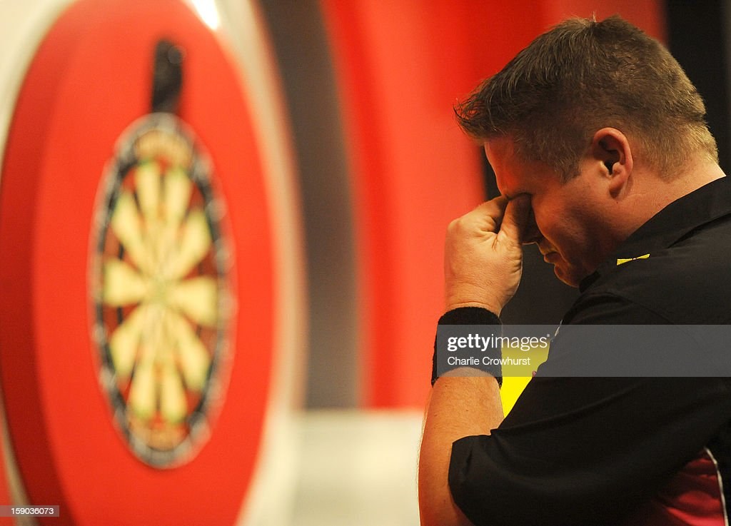 <a gi-track='captionPersonalityLinkClicked' href=/galleries/search?phrase=Scott+Mitchell&family=editorial&specificpeople=228843 ng-click='$event.stopPropagation()'>Scott Mitchell</a> of England gets emotional after he wins his first round match against Mark Barilli of Scotlands on day two of the BDO Lakeside World Professional Darts Championships at Lakeside Country Club on January 06, 2013 in London, England.