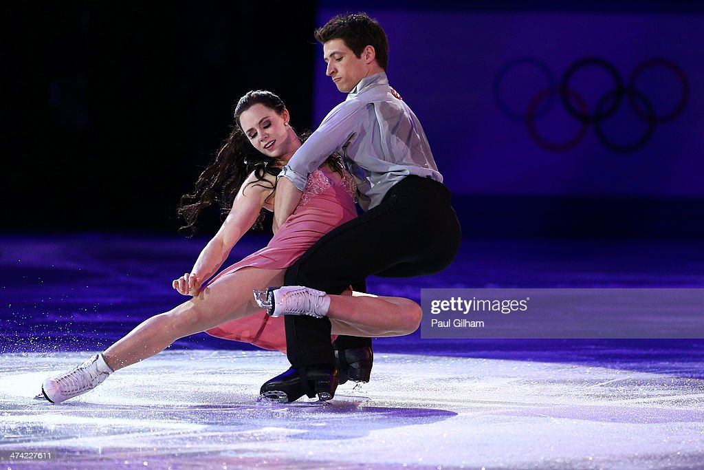 <a gi-track='captionPersonalityLinkClicked' href=/galleries/search?phrase=Scott+Moir&family=editorial&specificpeople=793313 ng-click='$event.stopPropagation()'>Scott Moir</a> and <a gi-track='captionPersonalityLinkClicked' href=/galleries/search?phrase=Tessa+Virtue&family=editorial&specificpeople=793314 ng-click='$event.stopPropagation()'>Tessa Virtue</a> of Canada performs during the Figure Skating Exhibition Gala at Iceberg Skating Palace on February 22, 2014 in Sochi.