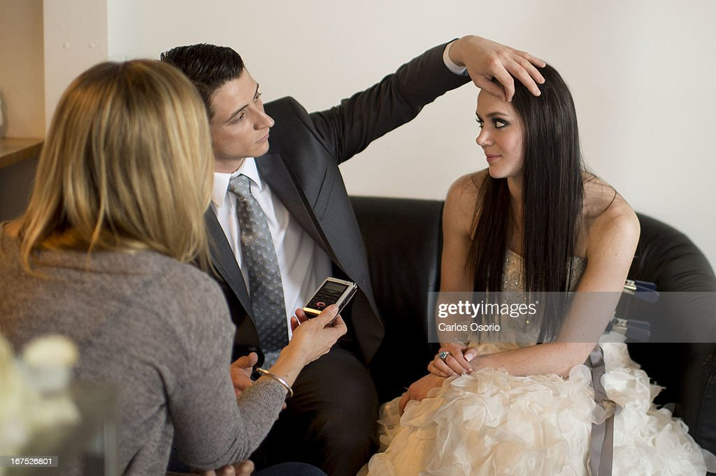 Scott Moir fixes Tessa Virtue's hair while being interviewed during a photo shoot for Today's Bride magazine.