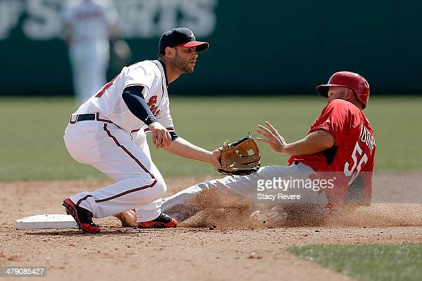 Scott Moore of the St Louis Cardinals slides into second base under the tag of Tommy LaStella of the Atlanta Braves in the eighth inning of a game at...