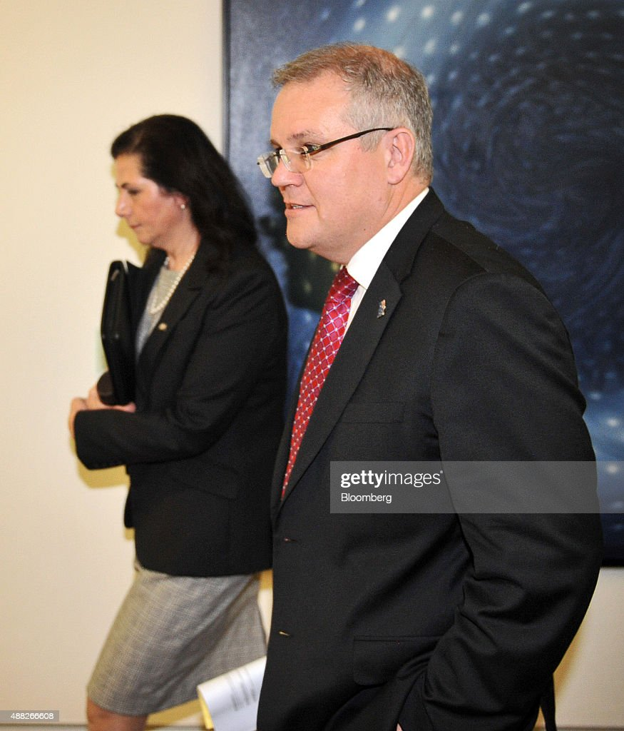 <a gi-track='captionPersonalityLinkClicked' href=/galleries/search?phrase=Scott+Morrison+-+Politician&family=editorial&specificpeople=15789813 ng-click='$event.stopPropagation()'>Scott Morrison</a>, Australia's minister for social services, right, walks along a corridor at Parliament House in Canberra, Australia, on Tuesday, Sept. 15, 2015. Malcolm Turnbull was sworn in as Australia's sixth prime minister in eight years after ousting Tony Abbott, pledging to revitalize an economy battered by the slowdown in China. Photographer: Mark Graham/Bloomberg via Getty Images