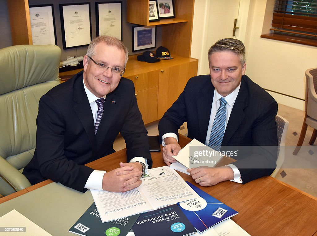 <a gi-track='captionPersonalityLinkClicked' href=/galleries/search?phrase=Scott+Morrison+-+Politician&family=editorial&specificpeople=15789813 ng-click='$event.stopPropagation()'>Scott Morrison</a>, Australia's treasurer, left, and Mathias Cormann, Australia's finance minister, pose for a photograph at Parliament House in Canberra, Australia, on Tuesday, May 3, 2016. Morrison, who will deliver the federal budget today, says the government won't spend any more than it saves on outlays, but also pledged not to increase the overall tax burden. Photographer: Mark Graham/Bloomberg via Getty Images