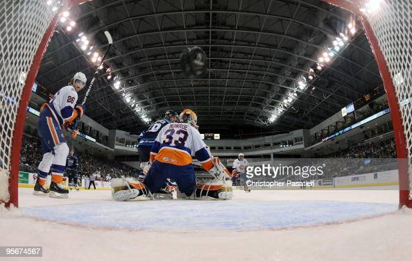 Scott Munroe of the Bridgeport Sound Tigers allows a goal during the first period against the Springfield Falcons on January 9 2010 at the Arena at...